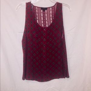 Sleeveless Red Blouse.